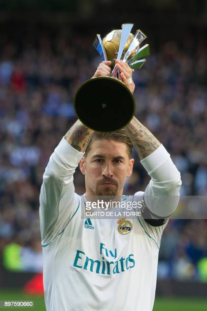 Real Madrid's Spanish defender Sergio Ramos receives the FIFA Club World Cup 2017 award before the Spanish League 'Clasico' football match Real...