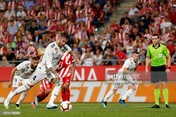 Real Madrid's Spanish defender Sergio Ramos shoots a penalty kick to score his team's opening goal during the Spanish league football match between...