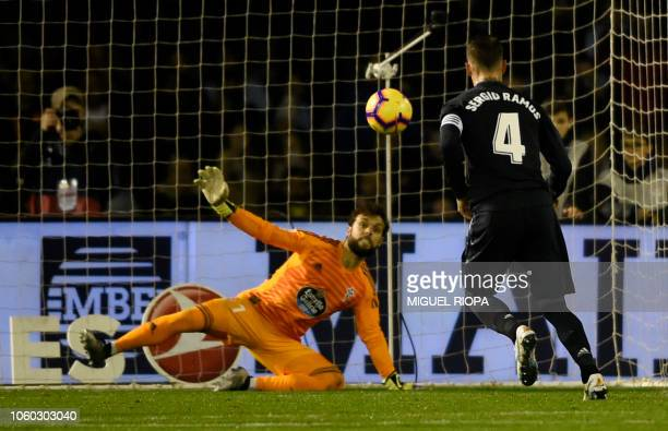 Real Madrid's Spanish defender Sergio Ramos shoots a penalty kick to score a goal to Celta Vigo's Spanish goalkeeper Sergio Alvarez during the...