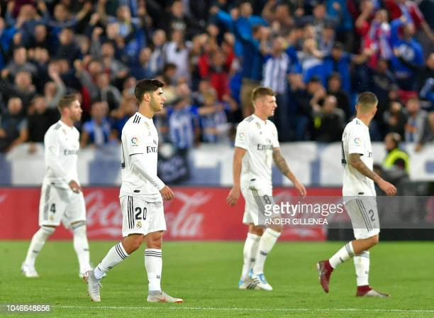 Real Madrid's Spanish defender Sergio Ramos Spanish midfielder Marco Asensio German midfielder Toni Kroos and Spanish defender Daniel Carvajal leave...