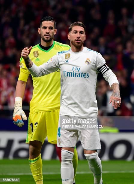 Real Madrid's Spanish defender Sergio Ramos stands beside Real Madrid's Spanish goalkeeper Kiko Casilla during the Spanish league football match...