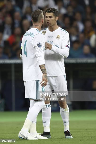 Real Madrid's Spanish defender Sergio Ramos talks with Real Madrid's Portuguese forward Cristiano Ronaldo during the UEFA Champions League final...
