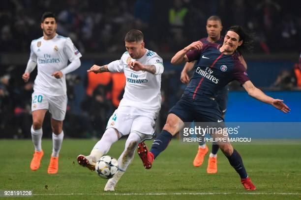Real Madrid's Spanish defender Sergio Ramos vies for the ball with Paris SaintGermain's Uruguayan forward Edinson Cavani during the UEFA Champions...