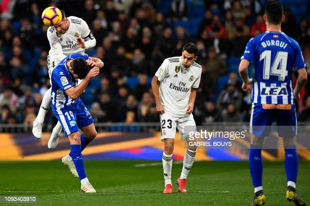 Real Madrid's Spanish defender Sergio Ramos vies with Alaves' Spanish midfielder Manu Garcia during the Spanish league football match Real Madrid CF...