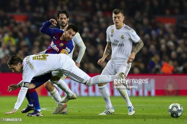 Real Madrid's Spanish defender Sergio Ramos vies with Barcelona's Argentinian forward Lionel Messi during Spanish El Clasico football match between...