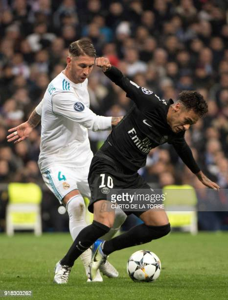 Real Madrid's Spanish defender Sergio Ramos vies with Paris SaintGermain's Brazilian forward Neymar during the UEFA Champions League round of sixteen...