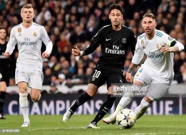 Real Madrid's Spanish defender Sergio Ramos vies with Paris SaintGermain's Brazilian forward Neymar AS Real Madrid's German midfielder Toni Kroos...