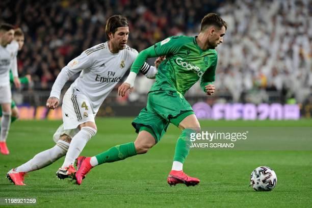 Real Madrid's Spanish defender Sergio Ramos vies with Real Sociedad's Belgian forward Adnan Januzaj during the Spanish Copa del Rey quarterfinal...