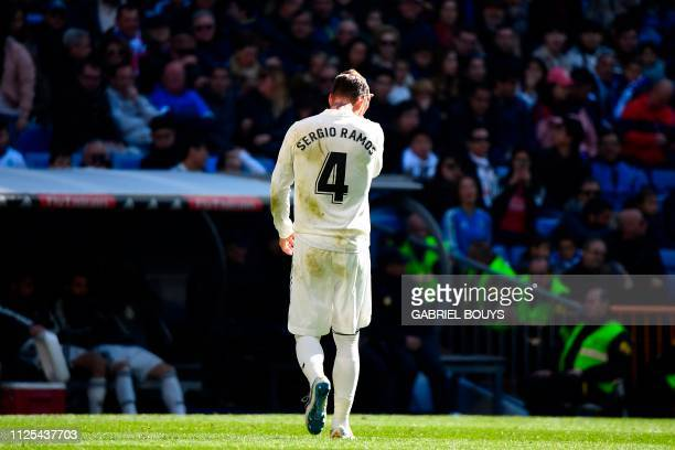 Real Madrid's Spanish defender Sergio Ramos walks off the pitch after receiving a red card during the Spanish League football match between Real...