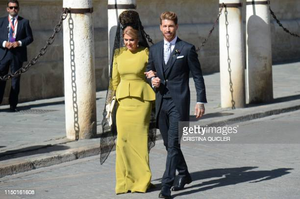Real Madrid's Spanish football player Sergio Ramos and his mother Paqui Gracia arrive at the Cathedral of Seville on June 15, 2019 for his wedding...