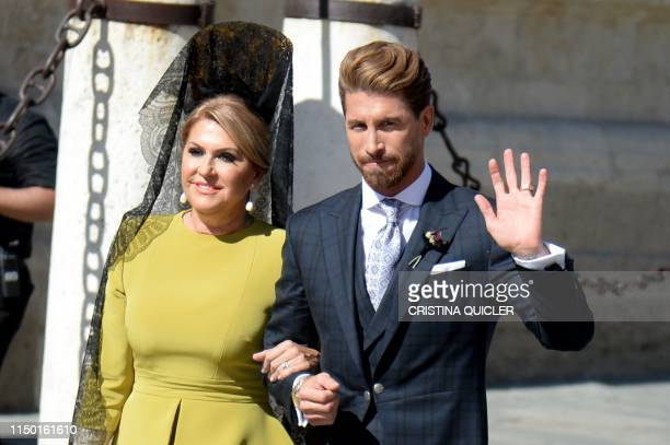 TOPSHOT Real Madrid's Spanish football player Sergio Ramos and his mother Paqui Gracia arrive at the Cathedral of Seville on June 15 2019 for his...