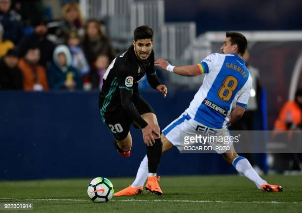 Real Madrid's Spanish forward Asensio vies with Legane's Brazilian midfielder Gabriel Apelt during the Spanish league football match Club Deportivo...