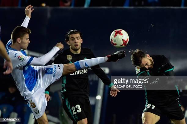 Real Madrid's Spanish forward Borja Mayoral challenges Leganes' Spanish midfielder Gerard Gumbau next to Real Madrid's Croatian midfielder Mateo...