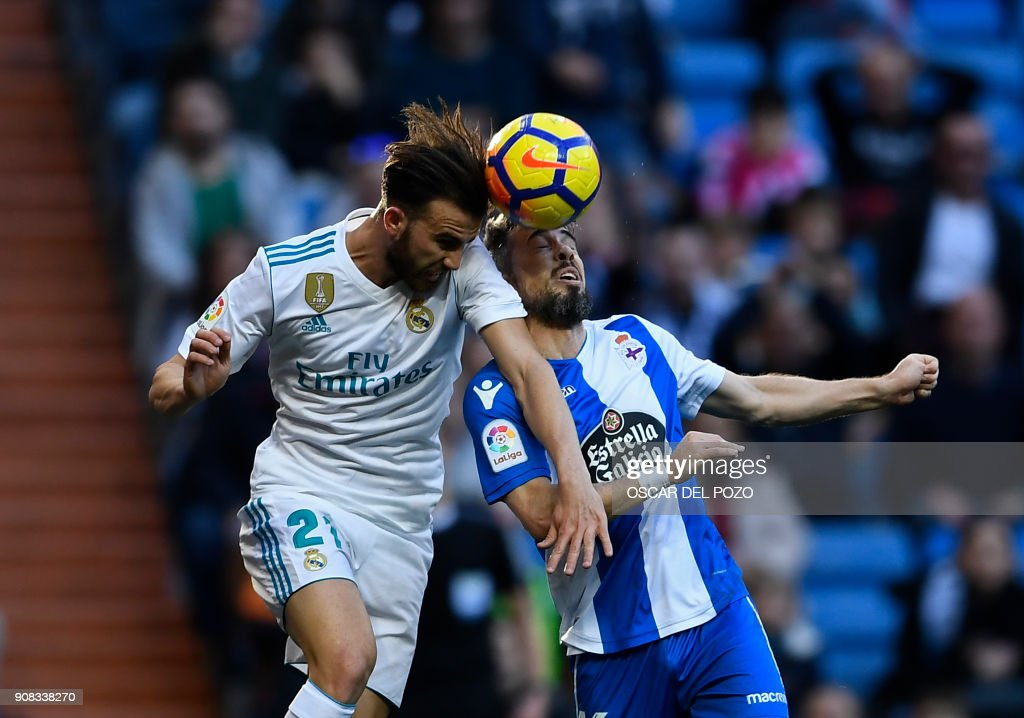 Real Madrid's spanish forward Borja Mayoral (L) vies with Deportivo La Coruna's Portuguese defender Luisinho (R) during the Spanish league football match between Real Madrid CF and RC Deportivo de la Coruna at the Santiago Bernabeu stadium in Madrid on January 21, 2018. /