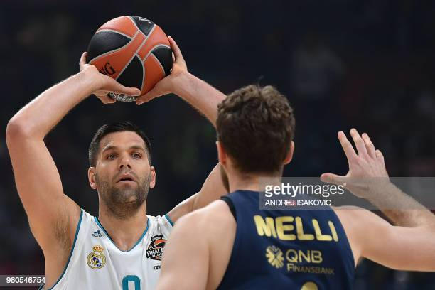 Real Madrid's Spanish forward Felipe Reyes controls the ball from Fenerbahce's Italian forward Nicolo Melli during the Euroleague Final Four finals...