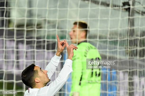 Real Madrid's Spanish forward Lucas Vazquez celebrates after scoring a goal during the Spanish League football match between Real Madrid and Celta...