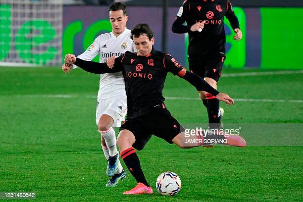 Real Madrid's Spanish forward Lucas Vazquez challenges Real Sociedad's Spanish midfielder Mikel Oyarzabal during the Spanish league football match...