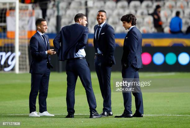 Real Madrid's Spanish forward Lucas Vazquez French defender Theo Hernandez Spanish academy goalkeeper Moha Ramos and Spanish defender Jesus Vallejo...