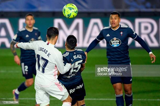 Real Madrid's Spanish forward Lucas Vazquez scores a header during the Spanish League football match between Real Madrid and Celta Vigo at the...