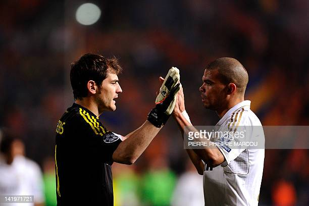 Real Madrid's Spanish goalkeeper Iker Casillas and Portuguese defender Pepe celebrate after beating APOEL in their UEFA Champions League first leg...