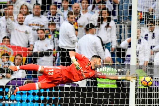 Real Madrid's Spanish goalkeeper Kiko Casilla dives for the ball during the Spanish league football match Real Madrid CF against Malaga CF on 25...