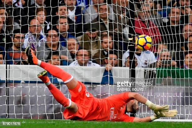Real Madrid's Spanish goalkeeper Kiko Casilla fails to stop the ball kicked by Malaga's Uruguayan midfielder Chory Castro during the Spanish league...
