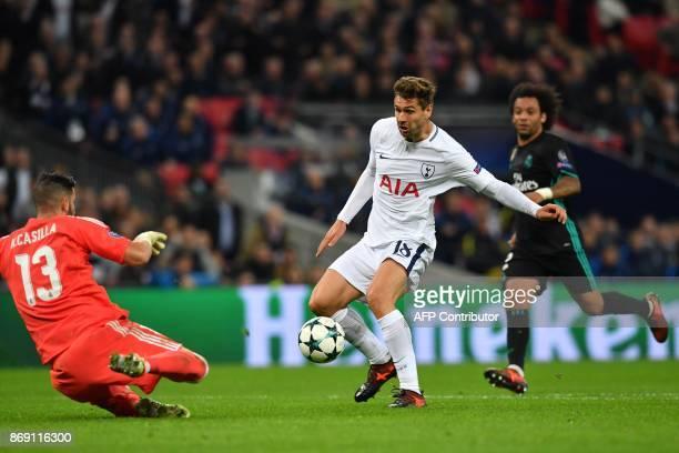 Real Madrid's Spanish goalkeeper Kiko Casilla slides in to save at the feet of Tottenham Hotspur's Spanish striker Fernando Llorente during the UEFA...