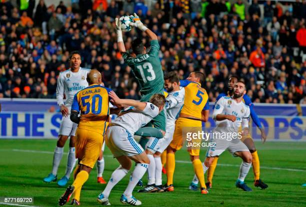 Real Madrid's Spanish goalkeeper Kiko Casilla takes hold of the cross during the UEFA Champions League Group H match between Apoel FC and Real Madrid...
