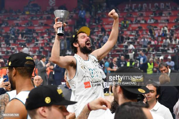 TOPSHOT Real Madrid's Spanish guard Sergio Llull celebrates after cutting the net down with team mates their 8580 win over Fenerbahce in the...