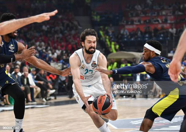 TOPSHOT Real Madrid's Spanish guard Sergio Llull grabs for the ball during the Euroleague Final Four finals basketball match between Real Madrid and...