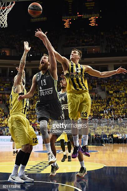 Real Madrid's Spanish guard Sergio Rodriguez vies for the ball with Fenerbahce Ulker`s forward Toni Antic and Serbian guard Bogdan Bogdanovic during...