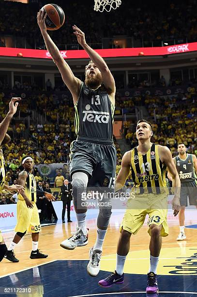 Real Madrid's Spanish guard Sergio Rodriguez vies with Fenerbahce Ulker's Serbian guard Bogdan Bogdanovic during the Euroleague basketball playoff...