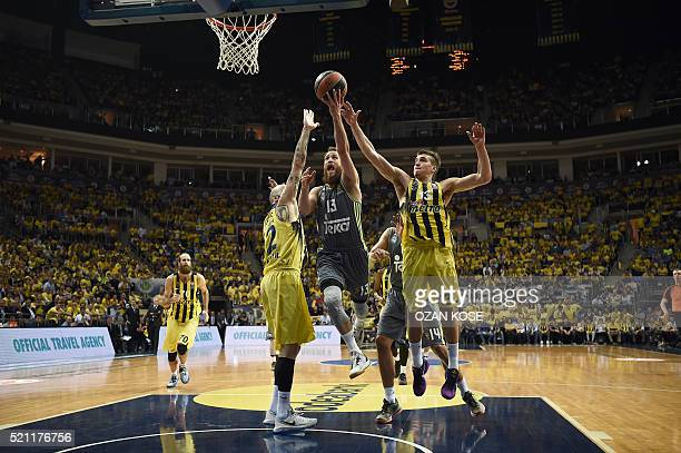 Real Madrid's Spanish guard Sergio Rodriguez vies with Fenerbahce Ulker's forward Toni Antic and Serbian guard Bogdan Bogdanovic during the...