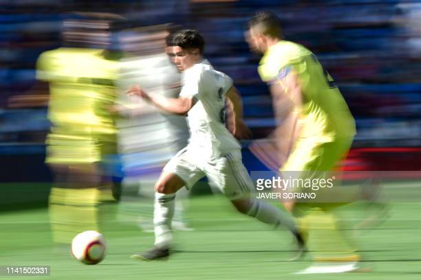 Real Madrid's Spanish midfielder Brahim Diaz dribbles the ball during the Spanish league football match between Real Madrid CF and Villarreal CF at...