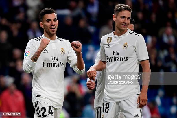 Real Madrid's Spanish midfielder Daniel Ceballos celebrates with Real Madrid's Spanish miedfieder Marcos Llorente after scoring a goal during the...