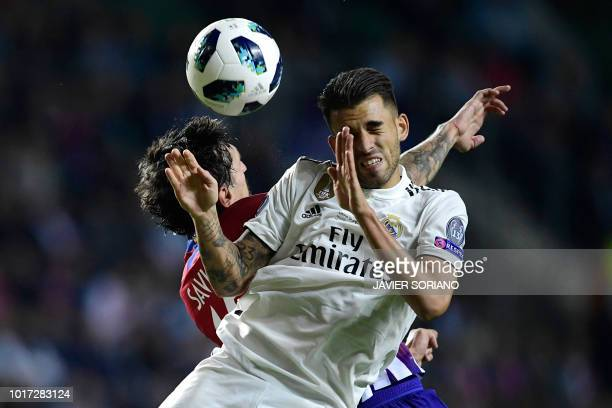 TOPSHOT Real Madrid's Spanish midfielder Daniel Ceballos heads the ball with Atletico Madrid's Montenegrin defender Stefan Savic during the UEFA...