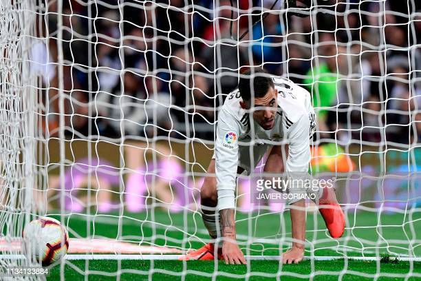 Real Madrid's Spanish midfielder Daniel Ceballos reacts after scoring a goal during the Spanish League football match between Real Madrid CF and SD...