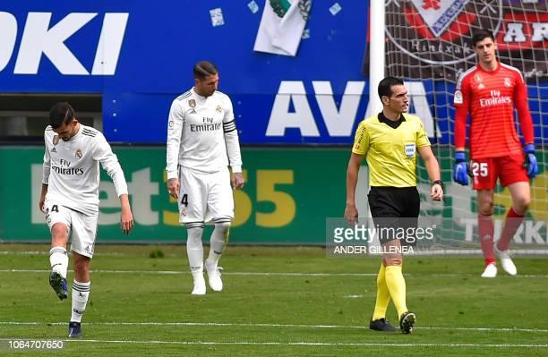 Real Madrid's Spanish midfielder Daniel Ceballos Real Madrid's Spanish defender Sergio Ramos and Real Madrid's Belgian goalkeeper Thibaut Courtois...
