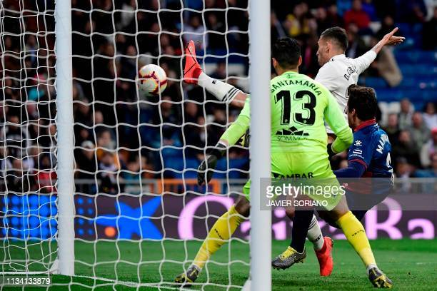 Real Madrid's Spanish midfielder Daniel Ceballos scores a goal during the Spanish League football match between Real Madrid CF and SD Huesca at the...