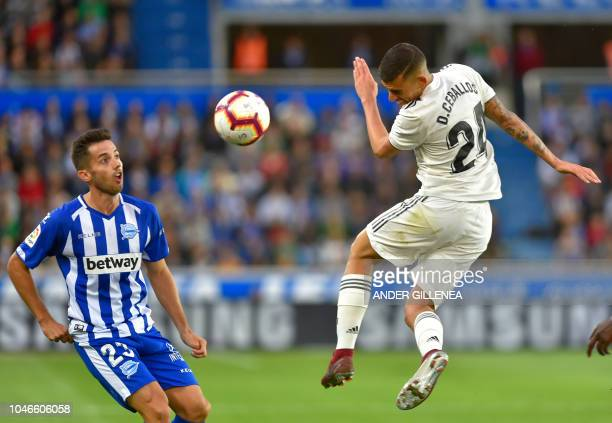 Real Madrid's Spanish midfielder Daniel Ceballos vies with Alaves' Spanish midfielder Jony during the Spanish league football match between Deportivo...