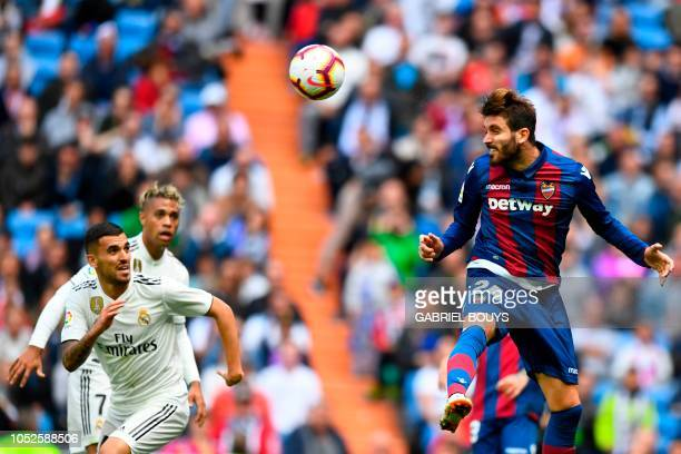 Real Madrid's Spanish midfielder Daniel Ceballos vies with Levante's Spanish midfielder Jose Campana during the Spanish league football match Real...