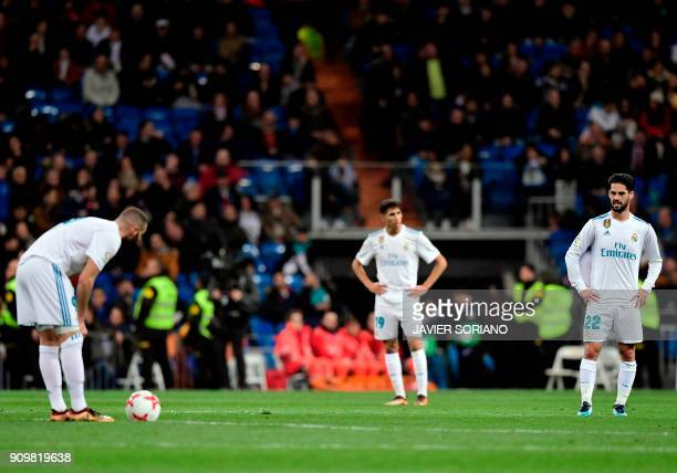 Real Madrid's Spanish midfielder Isco and teammates stand on the field after a goal by Leganes during the Spanish 'Copa del Rey' quarterfinal second...
