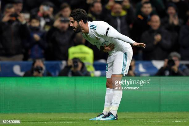 Real Madrid's Spanish midfielder Isco bows as he celebrates after scoring a goal during the Spanish league football match Real Madrid CF vs UD Las...