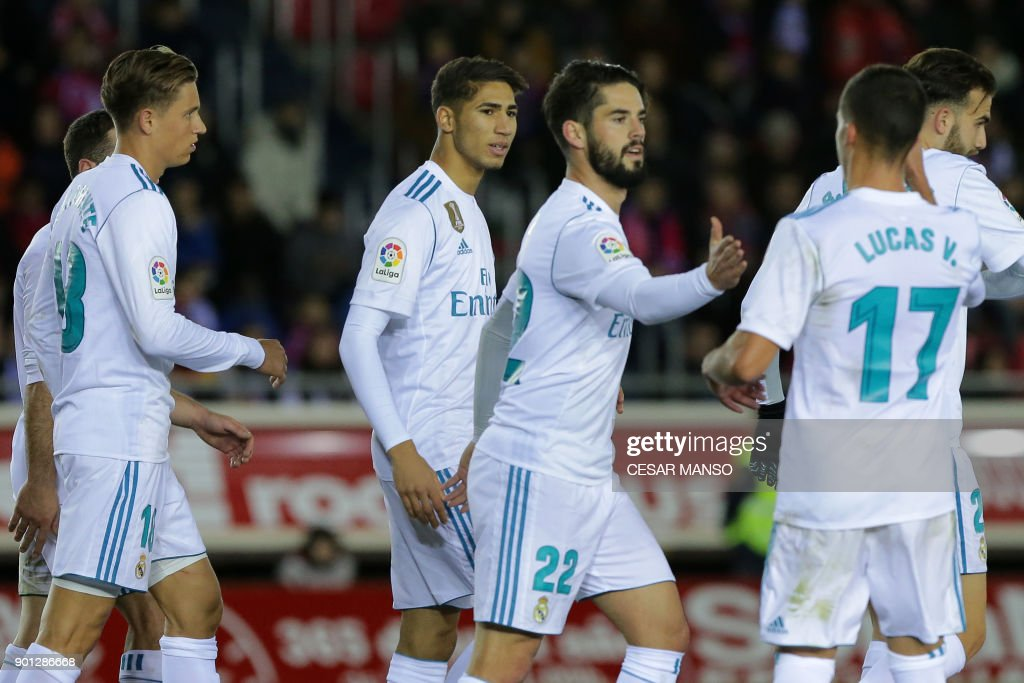 Real Madrid's Spanish midfielder Isco (C) celebrates a goal during the Spanish Copa del Rey (King's Cup) round of 16 first leg football match CD Numancia vs Real Madrid CF at Nuevo Estadio Los Pajaritos stadium in Soria on January 4, 2018. /