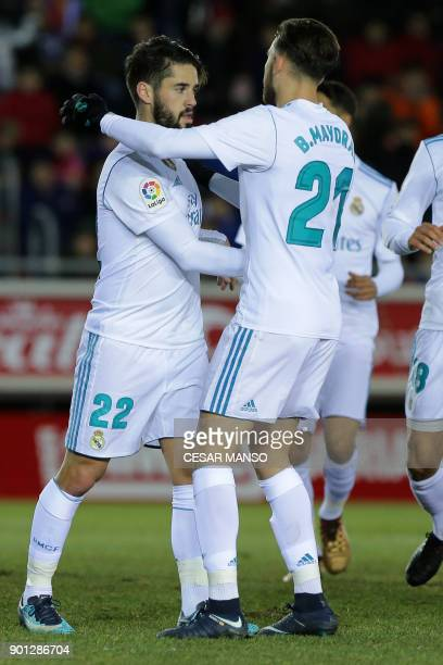 Real Madrid's Spanish midfielder Isco celebrates a goal during the Spanish Copa del Rey round of 16 first leg football match CD Numancia vs Real...