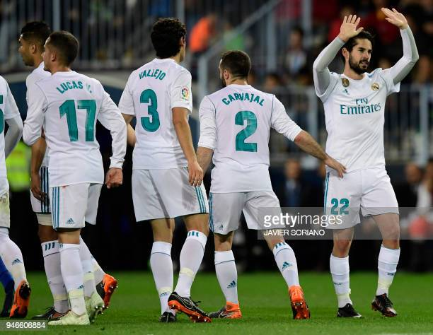 Real Madrid's Spanish midfielder Isco celebrates a goal during the Spanish league footbal match between Malaga CF and Real Madrid CF at La Rosaleda...