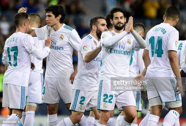 Real Madrid's Spanish midfielder Isco celebrates a goal with teammates during the Spanish league footbal match between Malaga CF and Real Madrid CF...
