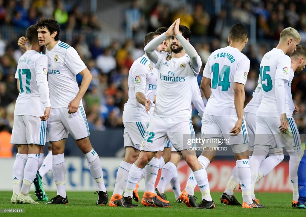 Real Madrid's Spanish midfielder Isco (C) celebrates a goal with teammates during the Spanish league footbal match between Malaga CF and Real Madrid CF at La Rosaleda stadium in Malaga on April 15, 2018. /