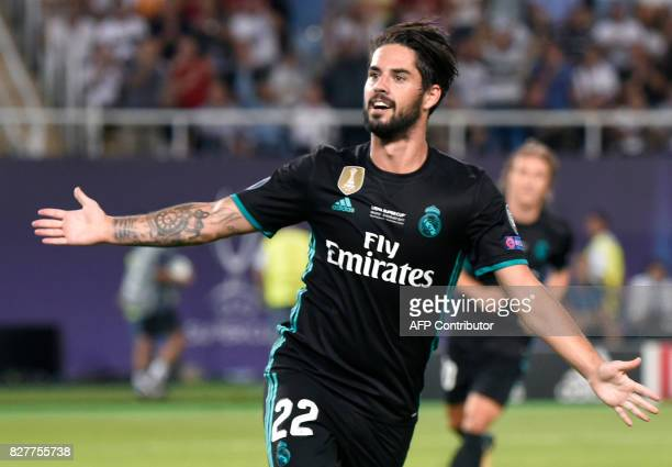 Real Madrid's Spanish midfielder Isco celebrates after scoring a goal during the UEFA Super Cup football match between Real Madrid and Manchester...