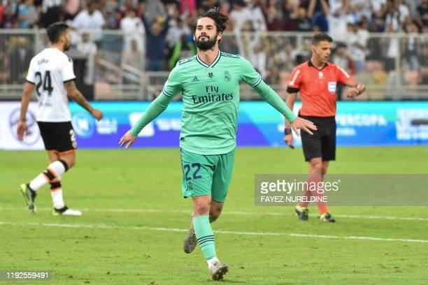 Real Madrid's Spanish midfielder Isco celebrates his goal during the Spanish Super Cup semi final between Valencia and Real Madrid on January 8 at...